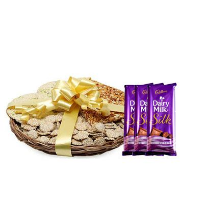 Lohri Sweets in Basket with Silk